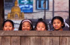 Group of nepalese schoolgirl. BHAKTAPUR, NEPAL - JANUARY 08: Group of nepalese schoolgirl - outdoor games on the street of old town on January 08, 2010 in Stock Photography