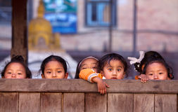 Group of nepalese schoolgirl. BHAKTAPUR, NEPAL - JANUARY 08: Group of nepalese schoolgirl - outdoor games on the street of old town on January 08, 2010 in Stock Photo