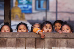 Group of Nepalese schoolgirl. BHAKTAPUR, NEPAL - JANUARY 08: Group of Nepalese schoolgirl - outdoor games on the street of old town on January 08, 2010 in Royalty Free Stock Images