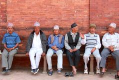 Group of Nepali old men wearing  traditional caps and chit-chatting Stock Images