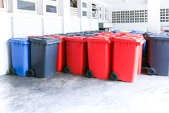 Group of new large colorful wheelie bins for rubbish, recycling waste. Large trash cans garbage bins stock image