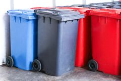 Group of new large colorful wheelie bins for rubbish, recycling waste. Large trash cans garbage bins royalty free stock photography