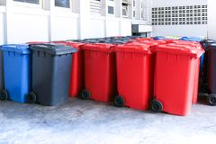Group of new large colorful wheelie bins for rubbish, recycling waste. Large trash cans garbage bins royalty free stock photos