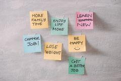 Group of New year Resolution Notes on pink, yellow, orange and g stock images