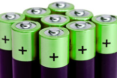 Group of nine green finger-type batteries of the AA size on a white background Royalty Free Stock Image