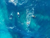 Group of novice surfers are learning to embark on wave. Aerial top view royalty free stock image