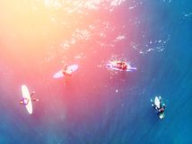 Group of novice surfers are learning to embark on wave. Aerial top view stock photos