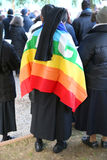 group of nuns with black veil and colored flag of peace Stock Image