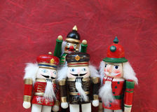 Group of nutcrackers on red background Stock Photo