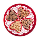 Group of nuts in heart shape bowls Royalty Free Stock Image