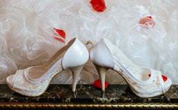 Group object of wedding jewellery accessory, church rings, necklace and shoes Stock Photo