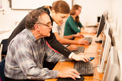 Free Group Of Adults Learning Computer Skills. Intergenerational Tran Stock Photography - 66171692