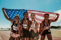 Free Group Of Athletes Celebrating Winning Gold Royalty Free Stock Images - 180375269