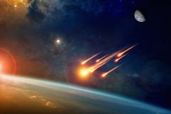 Free Group Of Burning Exploding Asteroids Approaches To Planet Earth Royalty Free Stock Photography - 102878297