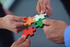 Group Of Business People Assembling Jigsaw Puzzle Royalty Free Stock Images