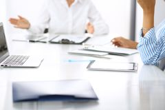 Free Group Of Business People At Meeting In Office, Close-up. Team Of Two Women Discussing Deal. Negotiation Concept Stock Photo - 131134280