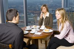 Group Of Business People At The Table Stock Photo