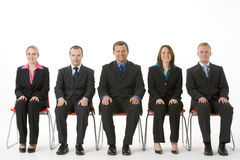 Free Group Of Business People Sitting In A Line Royalty Free Stock Photography - 6879497