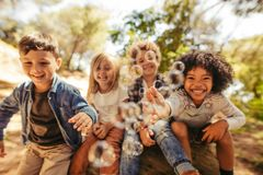 Free Group Of Children Playing With Soap Bubbles Stock Images - 147493464