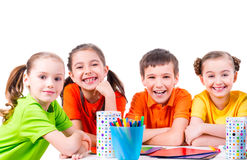 Free Group Of Children Sitting At A Table. Stock Photo - 47545270
