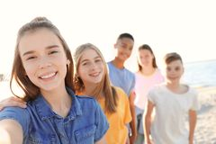 Group Of Children Taking Selfie On Beach Royalty Free Stock Images