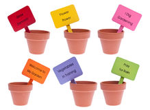 Group Of Clay Pots With Vibrant Colored Blank Sign Stock Photography