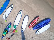 Free Group Of Color Boards For Stand Up Paddle Surfing Or SUP Lying On Beach At Sea Waves Background At Summer Day Royalty Free Stock Photos - 157557658