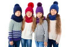 Free Group Of Cute Kids In Winter Warm Hats And Scarfs On White. Children Winter Clothes Stock Photos - 104850303