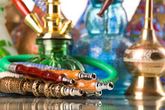 Group Of Eastern Hookahs On White Background Stock Photos