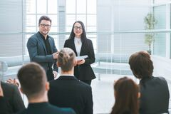 Free Group Of Employees Discussing A New Strategy At A General Meeting. Royalty Free Stock Photo - 184144385