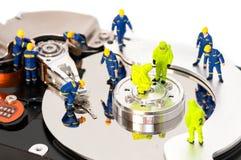 Free Group Of Engineers Maintaining Hard Drive Stock Photos - 29035893
