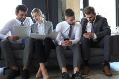 Free Group Of Four Business People Sitting On Sofa. They Couldn`t Be Happier About Working Together Stock Image - 146697321