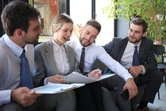 Free Group Of Four Business People Sitting On Sofa. They Couldn`t Be Happier About Working Together Royalty Free Stock Photo - 146697395