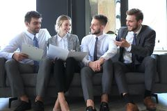 Free Group Of Four Business People Sitting On Sofa. They Couldn`t Be Happier About Working Together Royalty Free Stock Photography - 147401597