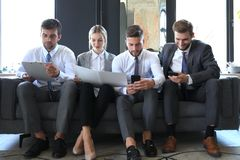 Free Group Of Four Business People Sitting On Sofa. They Couldn`t Be Happier About Working Together Royalty Free Stock Images - 147401879
