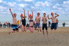 Free Group Of Friend Celebrating Their New Year Dip In The Cold Beach Water Stock Photos - 207938973