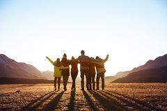 Free Group Of Friends Against Sunset Mountains Royalty Free Stock Photography - 127823697