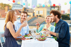 Free Group Of Friends Eating Meal On Rooftop Terrace Stock Images - 40097124