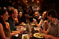 Free Group Of Friends Enjoying Meal In Restaurant Royalty Free Stock Images - 67526039