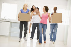 Group Of Friends Moving Into New Home Stock Photography