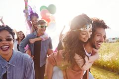 Free Group Of Friends Walking Back To Tent After Outdoor Music Festival With Balloons And Smoke Flare Stock Photography - 163725872
