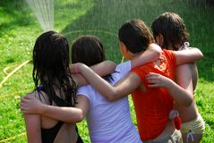 Free Group Of Girls And Sprinkler Royalty Free Stock Photos - 828878