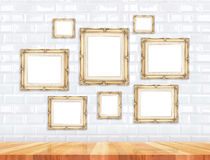 Group Of Golden Victorian Style Vintage Frames On White Tile Wall And Wood Floor,Mock Up For Adding Your Photo On Picture Frames Royalty Free Stock Photos