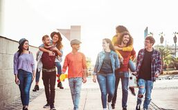 Free Group Of Happy Friends Having Fun Outdoor - Young People Piggybacking While Laughing And Walking Together In The City Center Royalty Free Stock Images - 187740759