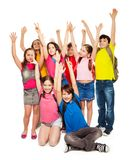 Group Of Happy Kids Lifting Hands Royalty Free Stock Images
