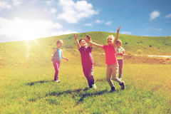 Free Group Of Happy Kids Running Outdoors Stock Photos - 94317493