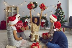 Free Group Of Happy Multiethnic Children Exchanging Presents Sitting On Floor In Living-room Stock Images - 199405174