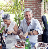 Group Of Happy People Is Eating Meat Outdoors Stock Photos