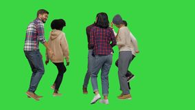 Free Group Of Happy Young People Dancing Together On A Green Screen, Chroma Key. Royalty Free Stock Images - 174655749