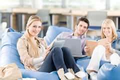 Group Of High-school Students With Books Sitting Stock Photography